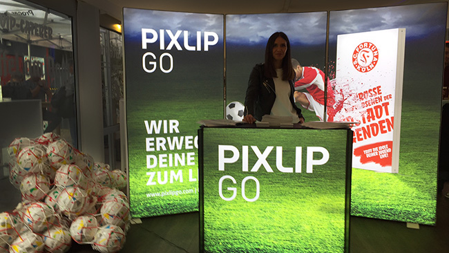 Bright promotion stand with colourful advertising print in the VIP area of Fortuna Cologne